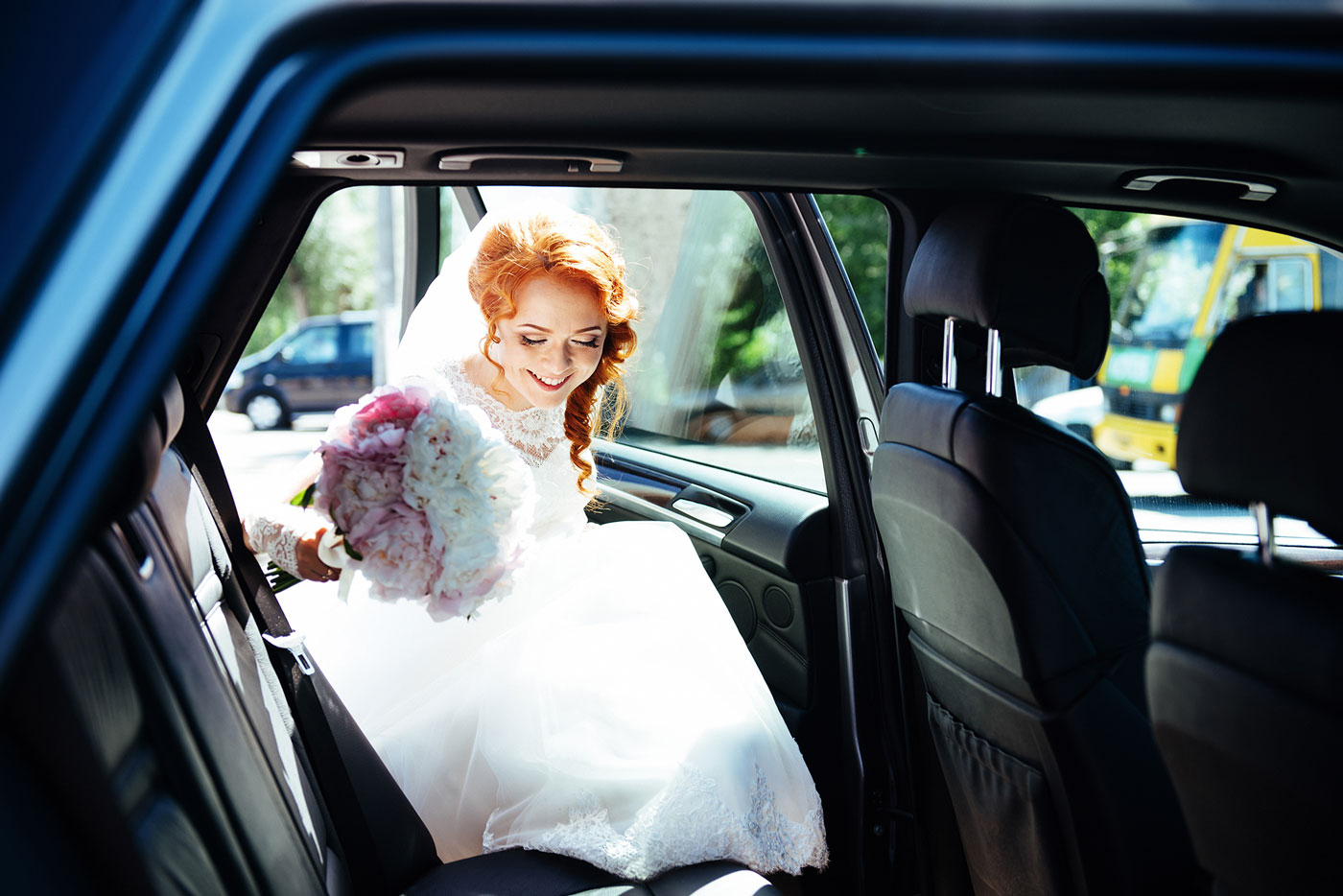 Bride getting in her wedding car